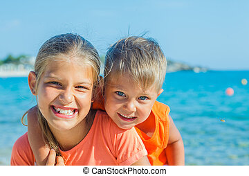 Smiling happy kids on the beach
