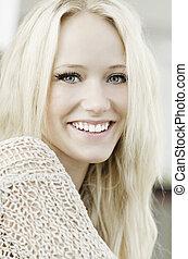 Smiling happy pretty blond woman