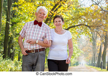 Smiling happy senior couple
