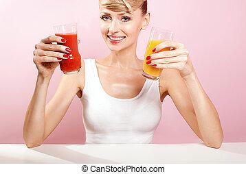 Smiling happy woman choosing juice.