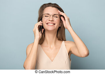 Smiling happy woman talking on phone, hearing good news
