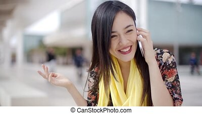 Smiling happy woman using a mobile phone