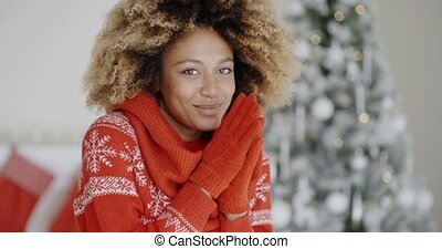Smiling happy young woman in a Christmas outfit