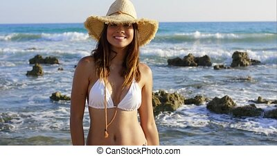 Smiling happy young woman on summer vacation