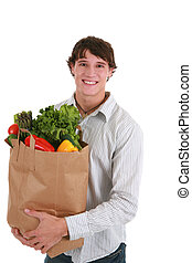 Smiling Healthy Young Man Holding Groceries Bag