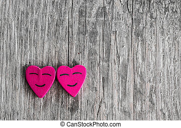 Smiling hearts on wood