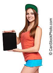 Smiling hip teen girl showing black blank digital tablet screen
