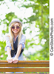Smiling hipster girl outdoors