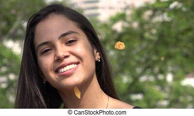 Smiling Hispanic Girl during Autumn