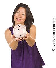 Smiling Hispanic Woman Holding Piggy Bank on White