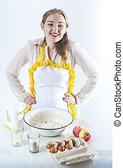 Smiling homemaker - Photo of young smiling housewife in ...