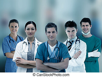 Smiling hospital workers standing arms crossed in line on...