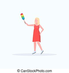 smiling housewife holding dust brush woman cleaner dusting cleaning service housework concept full length flat white background