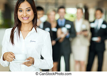 indian businesswoman having coffee during conference break