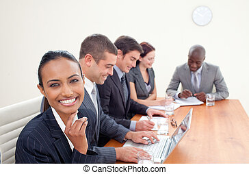 Smiling Indian businesswoman in a meeting