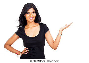 smiling indian businesswoman presenting on white background