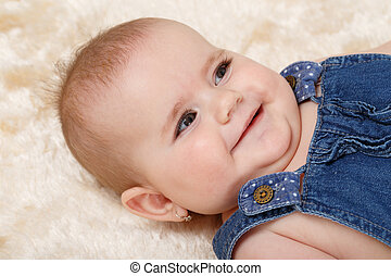 smiling infant baby - the first year of the new life