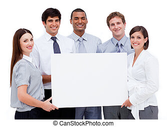 Smiling international business people holding a white card...