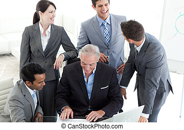 Smiling international business people studying a document