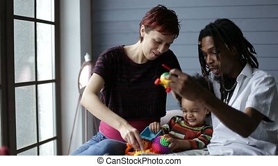 Smiling interracial family enjoying time together
