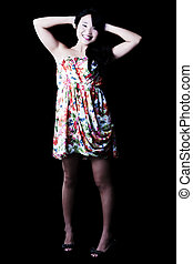 Smiling Japanese American Woman Standing In Floral Dress