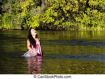 Smiling Japanese American Woman Standing In River