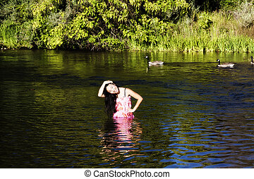 Smiling Japanese American Woman Standing In River With Geese