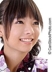 Smiling japanese girl face, closeup portrait of Asian woman...
