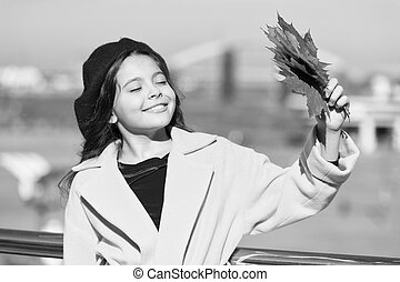 Smiling kid collecting memories. Farewell to autumn. Last autumn beams. Fall is in the air. Ideas for autumn leisure. Kid hold maple leaves. Small girl wear fall outfit outdoors. Autumn bucket list