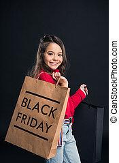 kid holding shopping bag