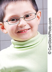 Smiling kid in eyeglasses
