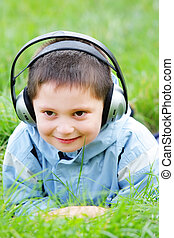 Smiling kid in headphones
