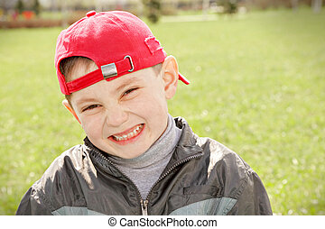 Smiling kid in red cap