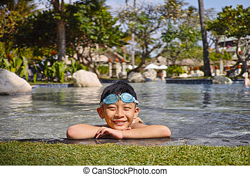smiling kid in swimming pool