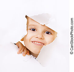 Smiling kid looking out of a hole