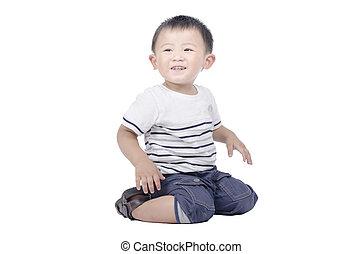 Smiling kid sit on the floor