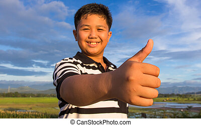 Smiling kid with thumbs-up gesture