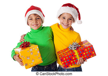 Smiling kids in Santa hats with gift boxes
