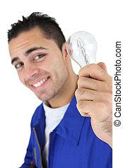 Smiling laborer holding light bulb