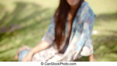 Smiling Lady at Grassy Ground Looking at Camera - Close up...