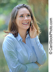Smiling lady on telephone outdoors