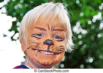 Smiling lion - The smiling face of a young child painted to...