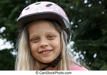 smiling little  bicyclist girl