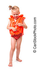 Smiling little blond girl in bathing suit and inflatable vest on white.