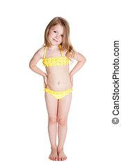 smiling little blone girl in yellow swimwear over white ...