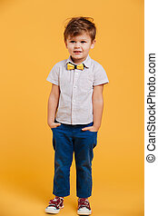 Smiling little boy child standing isolated