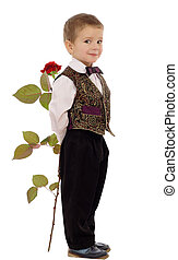 Smiling little boy hides a rose, isolated on white