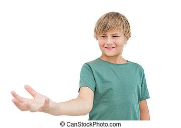 Smiling little boy holding something