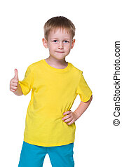 Smiling little boy holds his thumb up