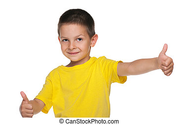 Smiling little boy holds his thumbs up